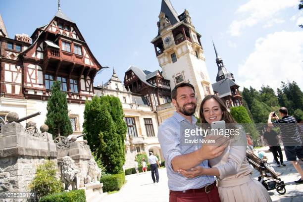 Prince Nicholas Of Romania and Princess Alina Of Romania pose in front of the Peles Castle on August 05 2018 in Sinaia Romania