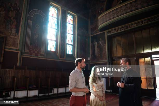 Prince Nicholas Of Romania and Princess Alina Of Romania speak to a priest at the Stabtul Illie Church on August 05 2018 in Sinaia Romania