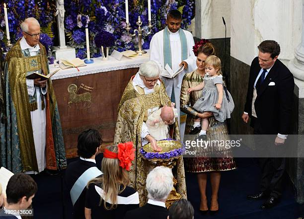 Prince Nicolas of Sween is christened at Drottningholm Palace as Princess Madeleine of Sweden holding Princess Leonore and Christopher O'Neill look...