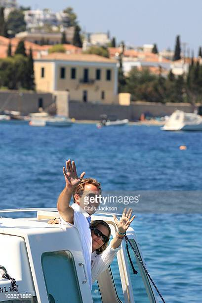 Prince Nikolaos and his fiance Tatiana Blatnik wave from a boat as they depart the Poseidon Hotel on the island of Spetses on August 24 2010 in...