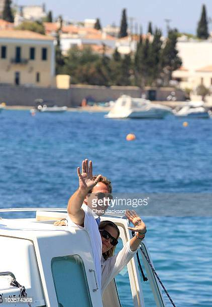 Prince Nikolaos and his fiance Tatiana Blatnik wave from a boat as they depart the Poseidon Hotel on the island of Spetses on August 24, 2010 in...