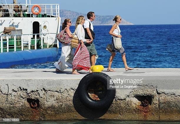 Prince Nikolaos and Tatiana Blatnik walk on the old harbour on August 24 2010 in Spetses Greece