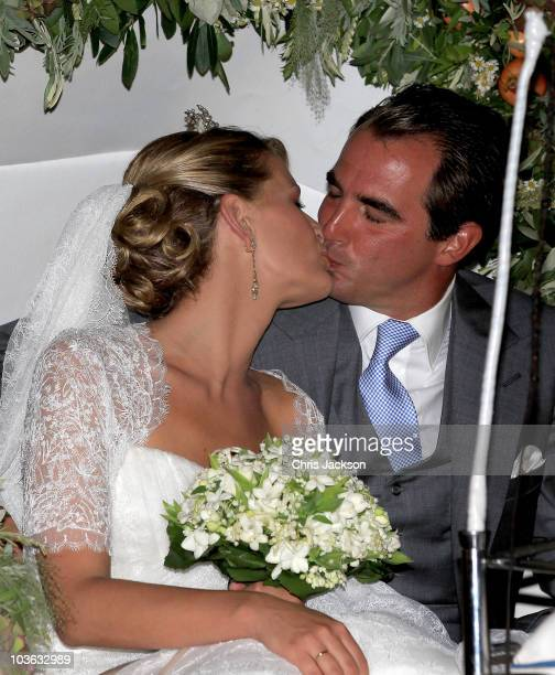 Prince Nikolaos of Greece and Princess Nikolaos of Greece and Denmark kiss after getting married at the Cathedral of Ayios Nikolaos on August 25 2010...