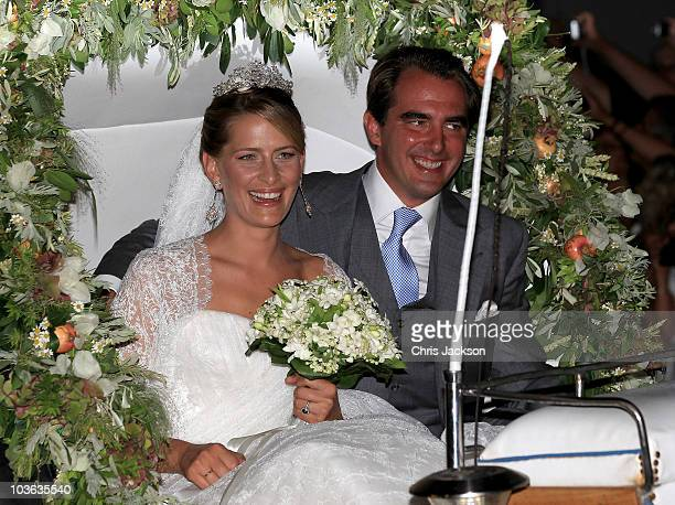 Prince Nikolaos of Greece and Princess Nikolaos of Greece and Denmark leave in a horse drawn carriage after getting married at the Cathedral of Ayios...