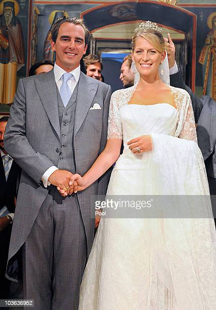 Prince Nikolaos of Greece and Tatania Blatnik pose during their wedding ceremony in the Cathedral of Ayios Nikolaos on August 25, 2010 in Spetses,...
