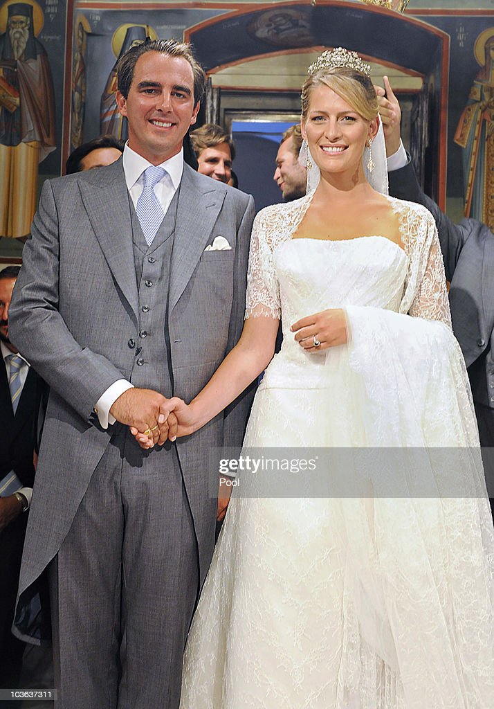 Prince Nikolaos of Greece and Tatania Blatnik (R) pose during their wedding ceremony in the Cathedral of Ayios Nikolaos (St. Nicholas) on August 25, 2010 in Spetses, Greece. Representatives from Europe?s royal families have joined the many guests who have travelled to the island to attend the wedding of Prince Nikolaos of Greece, the second son of King Constantine of Greece and Queen Anne-Marie of Greece and Tatiana Blatnik an events planner for Diane Von Furstenburg in London.