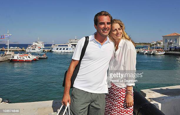 Prince Nikolaos of Greece and Tatiana Blatnik pose on the old harbour on August 24 2010 in Spetses Greece