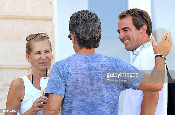 Prince Nikolaos of Greece chats to his future father in law Atilio Brillembourg as his future mother in law Marie-Blanche Brillembourg looks on at...