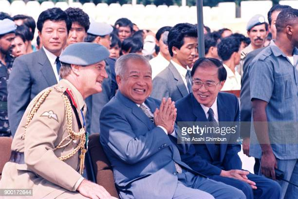 Prince Norodom Sihanouk of Cambodia and The United Nations Transitional Authority in Cambodia special representative Yasushi Akashi review the UNTAC...