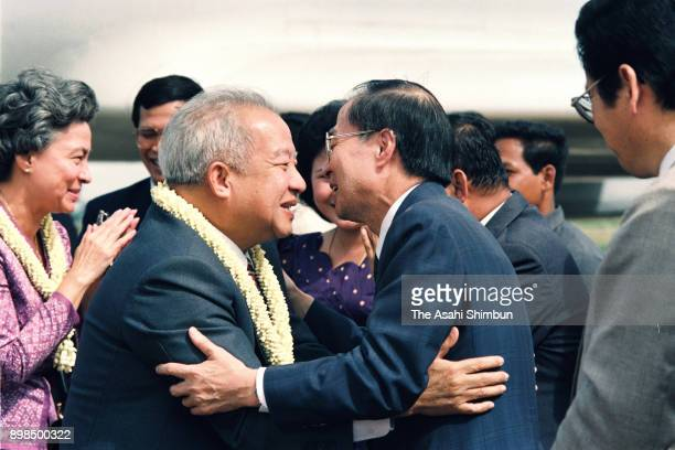 Prince Norodom Sihanouk of Cambodia is welcomed by United Nations Transitional Authority in Cambodia special representative Yasushi Akashi on arrival...