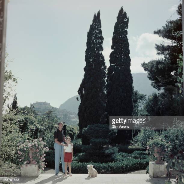 Prince of Capri Gaetano Parente and his son William Parente pose for a portrait on the island of Capri Italy in July 1958