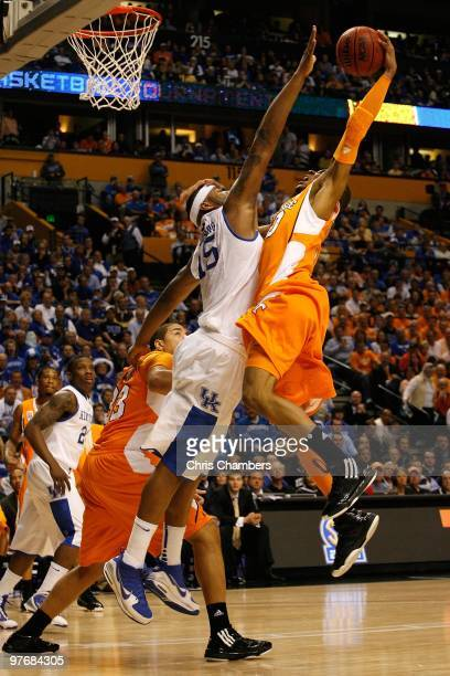 P Prince of the Tennessee Volunteers drives to the basket for a dunk attempt against DeMarcus Cousins of the Kentucky Wildcats during the semirfinals...