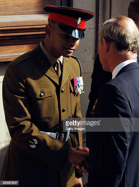 Prince of Wales shakes hands with Private Johnson Beharry VC as TRH The Prince of Wales the President of The Victoria Cross and George Cross...