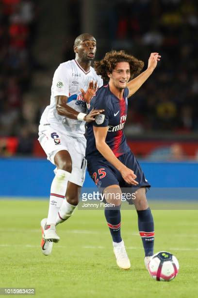 Prince Oniangue of Caen and Adrien Rabiot of PSG during the French Ligue 1 match between Paris Saint Germain and Caen at Parc des Princes on August...