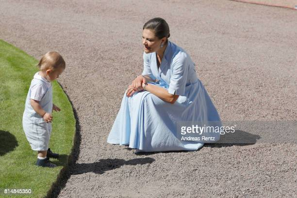 Prince Oscar of Sweden and Crown Princess Victoria of Sweden are seen meeting the people gathered in front of Solliden Palace to celebrate the 40th...