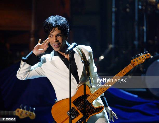 Prince performs after being inducted into the Rock and Roll Hall of Fame
