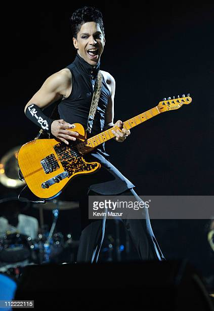 """Prince performs during his """"Welcome 2 America"""" tour at The Forum on April 14, 2011 in Inglewood, California."""