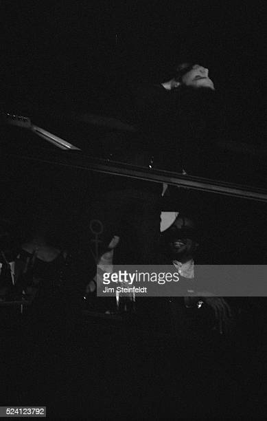 Prince performs leaning over the balcony at his Glam Slam nightclub in Minneapolis Minnesota on January 6 1991