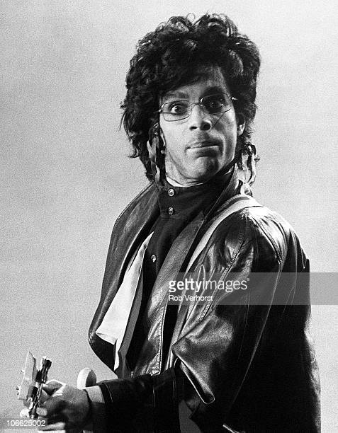 Prince performs on stage wearing glasses and looking to camera at Ahoy on 26th June 1987 in Rotterdam Netherlands