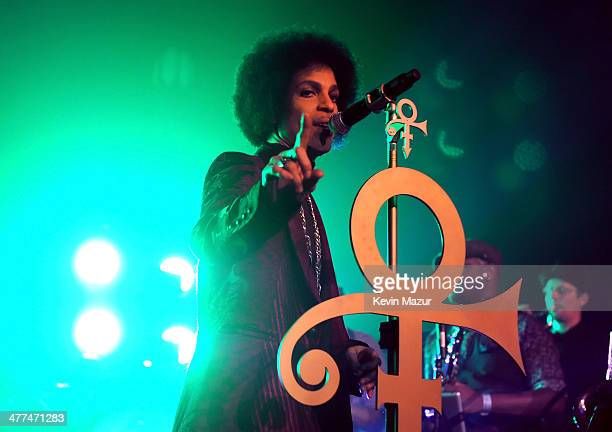 Prince performs onstage at The Hollywood Palladium on March 8 2014 in Los Angeles California
