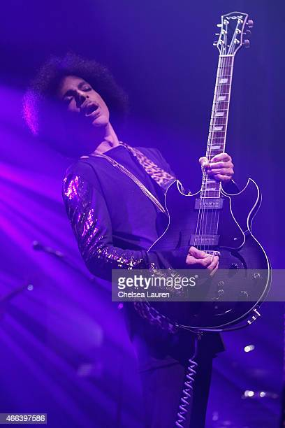 Prince performs onstage during the HitnRun tour opener at The Louisville Palace on March 14 2015 in Louisville Kentucky