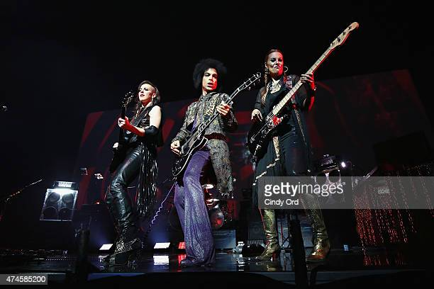 Prince performs onstage with 3RDEYEGIRL during his 'HitnRun' tour at Bell Centre on May 23 2015 in Montreal Canada