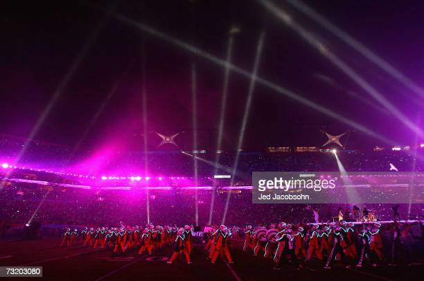 Prince performs with the Florida AM University marching band the Marching 100 during the 'Pepsi Halftime Show' at Super Bowl XLI between the...