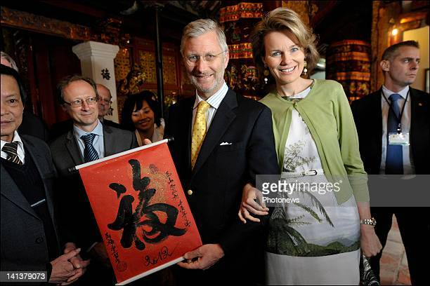 Prince Philip and Princess Mathilde of Belgium receive gifts from a local artist at the temple on day 1 of the official visit to Vietnam on March...