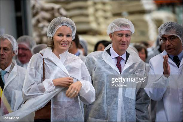 """Prince Philip and Princess Mathilde pictured visiting the """"Cafe Liegeois"""" firm that produces a fair trade coffee, on October 5, 2012 in Battice,..."""