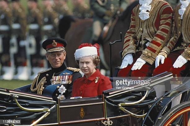 Prince Philip and Queen Elizabeth II wearing a hat designed by Ian Thomas travel in a horsedrawn carriage through Berlin while on a State Visit to...