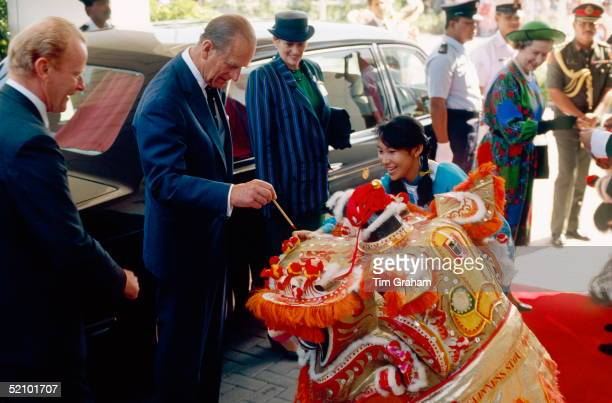 Prince Philip And The Queen Being Welcomed By Lion Dancers