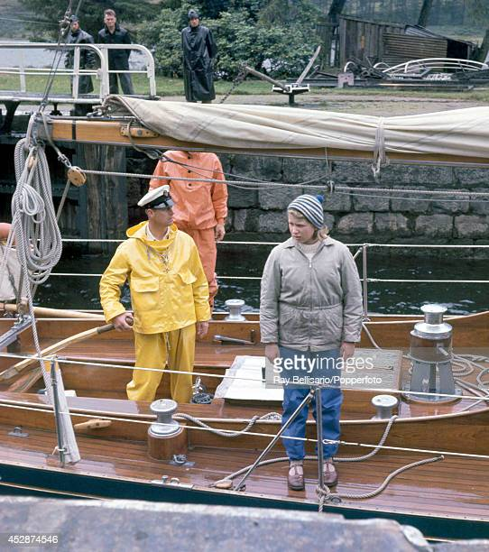 Prince Philip at the helm with Princess Anne on board the Royal Yawl Bloodhound during a sailing holiday on Loch Oich Invernesshire on 23rd August...