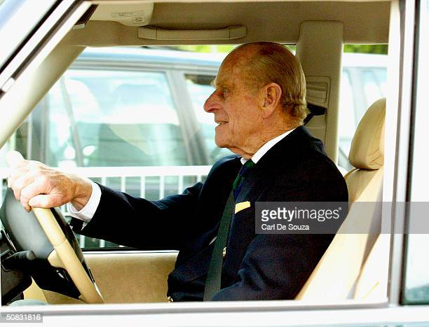 Prince Philip drives a Land Rover as he attends the first day of the Royal Windsor Horse Show at Home Park on May 13, 2004 in Windsor, England.
