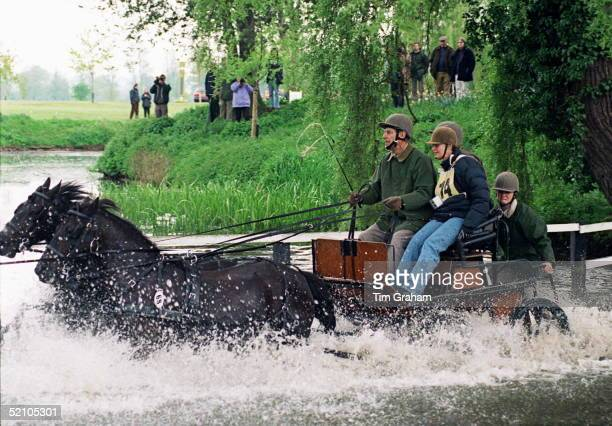 Prince Philip Driving The Queen's Team Of Fell Ponies Through The Water Obstacle At The Royal Windsor Horse