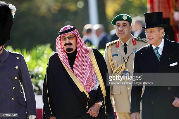 Prince Philip Duke of Edinburgh accompanies King Abdullah Bin Abdul Aziz Al Saud of Saudi Arabia as he inspects the Guard of Honour during a...