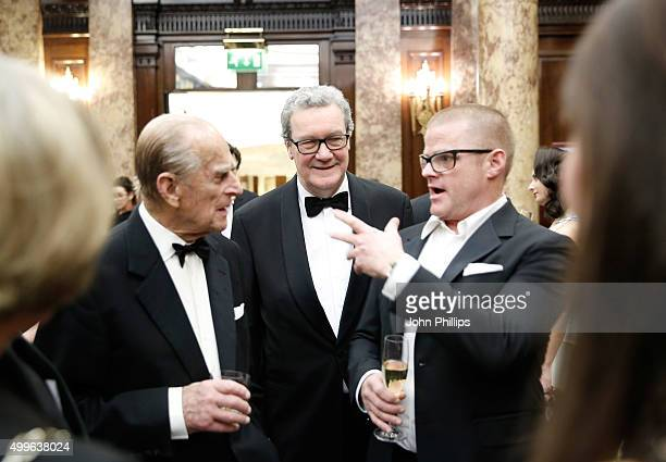 Prince Philip Duke of Edinburgh and Australian High Commissioner Alexander Downer listen to Heston Blumenthal at a drinks reception prior to a...