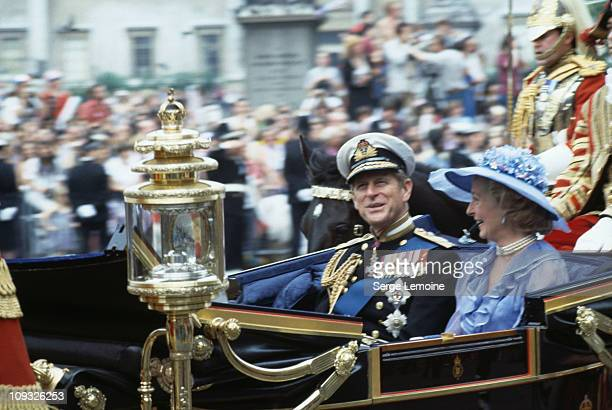 Prince Philip Duke of Edinburgh and Frances Shand Kydd the father of the groom and the mother of the bride during the wedding of Charles Prince of...
