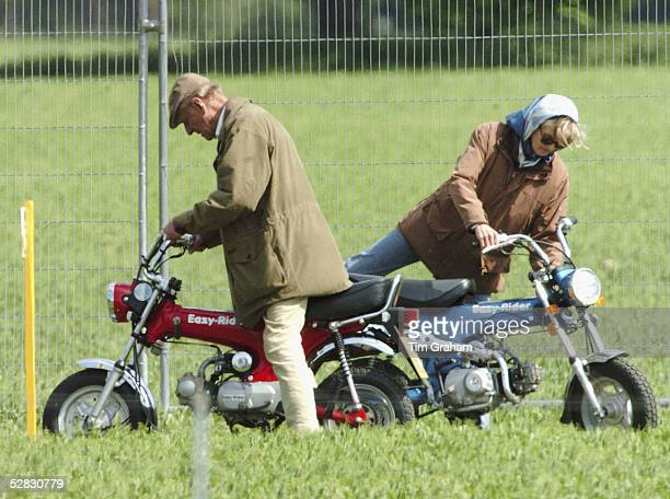 Prince Philip Duke of Edinburgh and his friend Lady Penny Romsey mount mini motorcycles to get around the Royal Windsor Horse Show on May 13 2005 in...