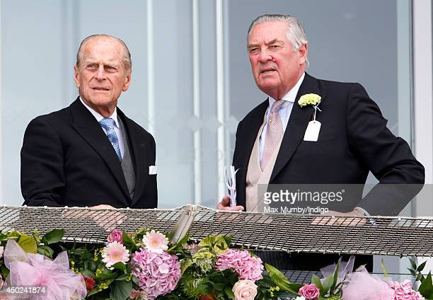 Prince Philip, Duke of Edinburgh and Lord Samuel Vestey attend Derby Day of the Investec Derby Festival at Epsom Racecourse on June 7, 2014 in Epsom,...