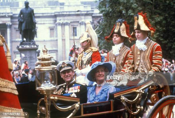 Prince Philip, Duke of Edinburgh and Mrs Frances Shand Kydd, mother of Princess Diana, ride in an open carriage as part of the wedding procession...