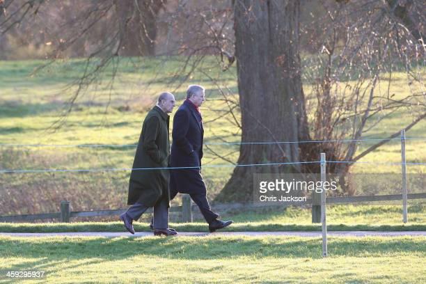 Prince Philip Duke of Edinburgh and Prince Andrew Duke of York arrive for the Christmas Day service at Sandringham on December 25 2013 in King's Lynn...