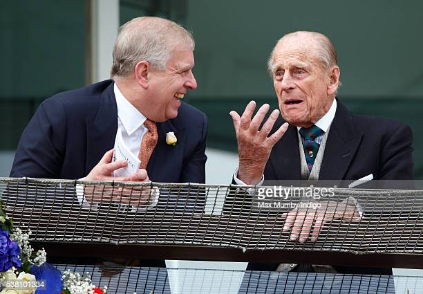 Prince Philip, Duke of Edinburgh and Prince Andrew, Duke of York watch the racing from the balcony of the Royal Box as they attend Derby Day during...