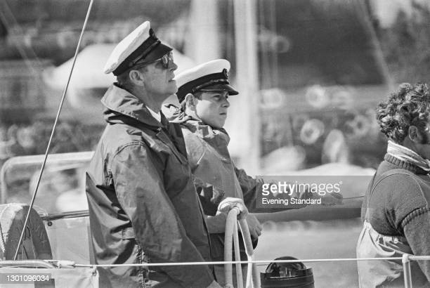 Prince Philip, Duke of Edinburgh and Prince Andrew on the yacht 'Yeoman XIX' at Cowes on the Isle of Wight, where they are competing in the Britannia...