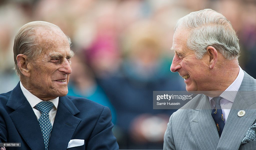 Prince Philip, Duke of Edinburgh and Prince Charles, Prince of Wales tour Queen Mother Square on October 27, 2016 in Poundbury, Dorset.