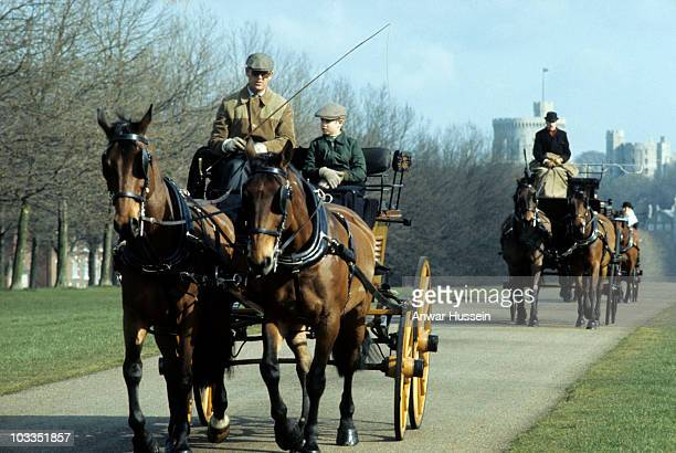 Prince Philip Duke of Edinburgh and Prince Edward go carriage driving up the Long Walk in Windsor Great Park in May 1977 in Windsor England