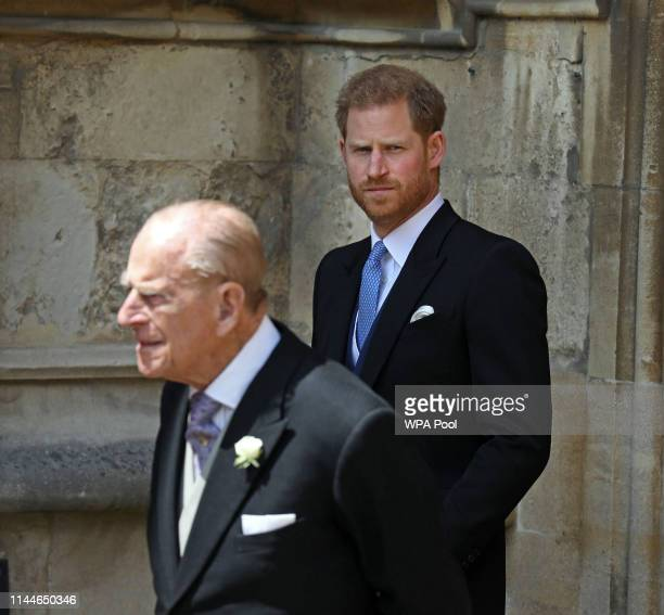Prince Philip Duke of Edinburgh and Prince Harry Duke of Sussex leave after the wedding of Lady Gabriella Windsor to Thomas Kingston at St George's...
