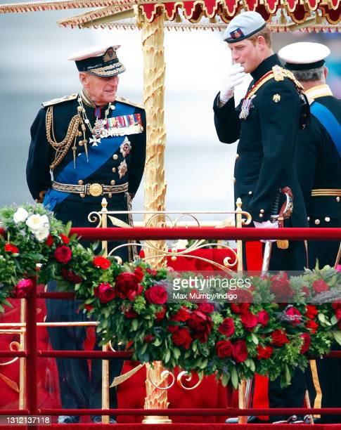 Prince Philip, Duke of Edinburgh and Prince Harry onboard the Royal Barge 'Spirit of Chartwell' during the Diamond Jubilee Thames River Pageant on...