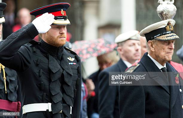 Prince Philip Duke of Edinburgh and Prince Harry visit The Field Of Remembrance at Westminster Abbey on November 5 2015 in London England