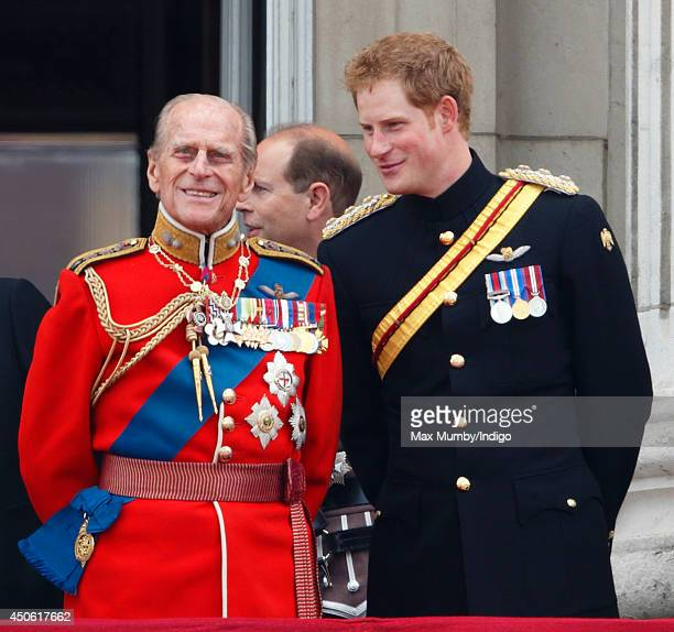 Prince Philip, Duke of Edinburgh and Prince Harry watch the fly-past from the balcony of Buckingham Palace during Trooping the Colour, Queen...