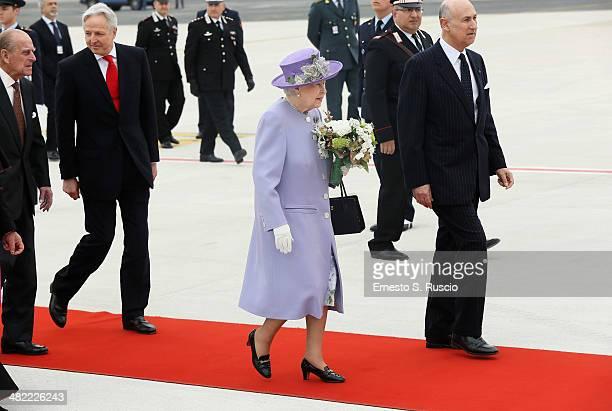Prince Philip Duke of Edinburgh and Queen Elizabeth II arrive at Ciampino Airport on April 3 2014 in Ciampino Italy The Queen and the Duke of...